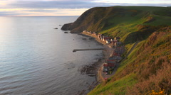 A small Scottish coastal fishing village at sunset. Stock Footage
