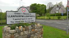 The town of Llanfairpwllgwyngyllgogerychwyrndrobwllllantysiliogogogoch in Wales Stock Footage