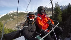 4k happy couple in chair lift ski slope snow mountains resort holidays sport - stock footage