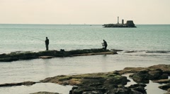 Two men fishing on a dock Stock Footage