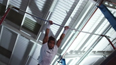 4K Professional male gymnast training on horizontal bar at the gym - stock footage