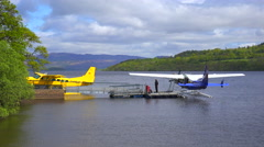 Float planes sit on a small bay on Loch Lomand, Scotland. Stock Footage