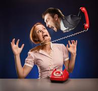 Mad boss is screaming to assistant from red phone Stock Photos