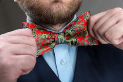 Straightening the butterfly tie - stock photo