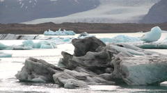 Black ice floating near coast Stock Footage