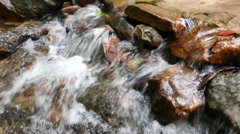 Stream water flow at waterfall Stock Footage