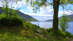 A pretty establishing shot of Loch Lomand, Scotland. Stock Footage