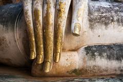 Gold Leaf Covered Buddha Hand Stock Photos