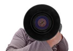 Photographer with big lens - stock photo