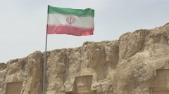 Naqsh-e Rustam necropolis and flag Stock Footage