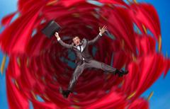 Businessman falls into abyss - stock photo
