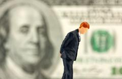 Figurine of loser businessman - stock photo