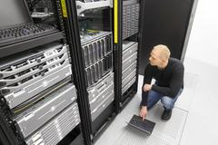 It consultant working with blade servers in datacenter Stock Photos