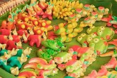 Thai dessert on green banana leaf place in market. Stock Photos