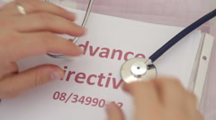 Doctor holding advance directives documents Stock Footage