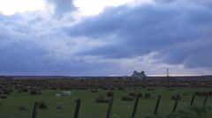 Dark clouds form over a farm during an impending storm in Northern Scotland. Stock Footage