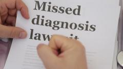 Doctor Review Missed Diagnosis lawsuit papers Stock Footage