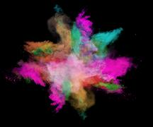 Freeze motion of colored dust explosions on black background - stock photo