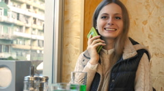 Smartphone woman having casual conversation on mobile phone laughing in cafe Stock Footage