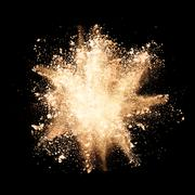 Stock Photo of Freeze motion of yellow dust explosions on black background