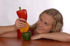 a young woman with paprika - stock photo