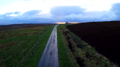 Aerial over a beautiful road through Scotland or Ireland after the rain with Stock Footage