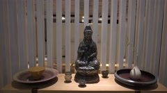a Kwan-yin Guanyin statue at home - stock footage