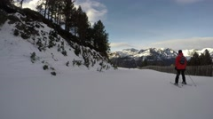 Stock Video Footage of 4k point of view pov ski skiing slopes trees snow mountains resort holidays