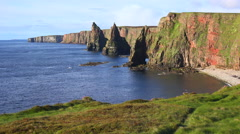 Establishing shot of the beautiful Duncansby Head sea stacks in Northern Stock Footage