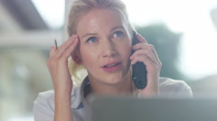 4K Portrait of attractive businesswoman working at her desk and talking on phone Stock Footage