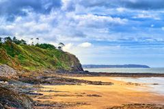 Desolated atlantic beach in Normandy by Granville, France Stock Photos
