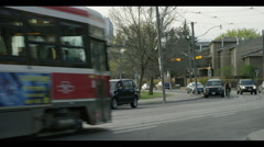 public transit drives by park area ES - stock footage