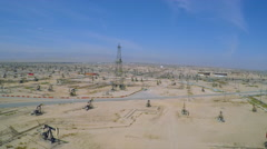 Amazing aerial shot over vast oil fields and derricks near Bakersfield, Stock Footage
