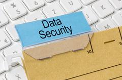A brown file folder labeled with Data Security - stock photo