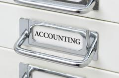 A drawer cabinet with the label Accounting - stock photo