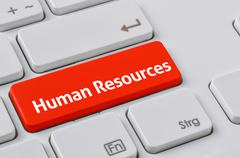 A keyboard with a red button - Human Resources - stock photo