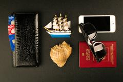 Travel accessories on black background top view Stock Photos
