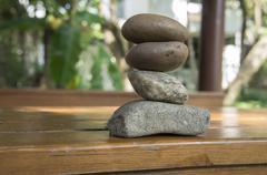 Zen rock tri Spiritual stack wood floor stone concept Stock Photos