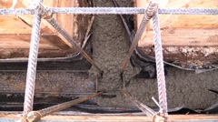 Concrete flows into a wooden formwork and reinforcement of the foundation Stock Footage