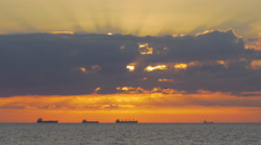 Stock Video Footage of Queue of bulk carriers on horizon during vivid summer sunset