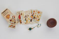 Tarot cards with old book and candle Stock Photos