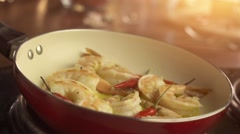 Shrimps on pan with red chilly pepper - stock footage