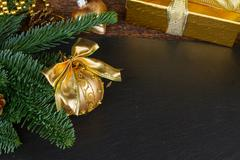 evergreen tree with golden decorations - stock photo
