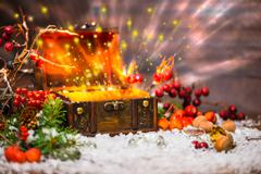 Christmas winter fairy with light miracle in opened chest. Background of myst - stock photo