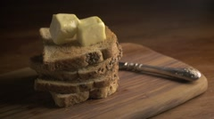 Stack of bread slices and melting butter Stock Footage