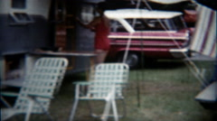 1960: Family campsite trailers parked around enjoying the warm summer day. Stock Footage