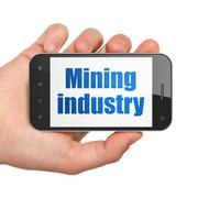 Industry concept: Hand Holding Smartphone with Mining Industry on display Piirros