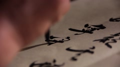 Write the hand of the Chinese calligraphy Stock Footage