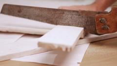 Sliding camera captures a process of a wooden board being cut by saw - stock footage