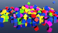 Many colorfull toy blocks falling on reflective table Stock Footage